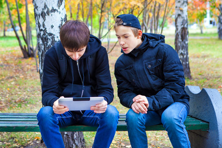 keek: Boys with Tablet Computer in the Autumn Park Stock Photo