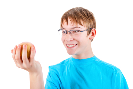 gladden: Teenager with an Apple Isolated on the White Background Stock Photo