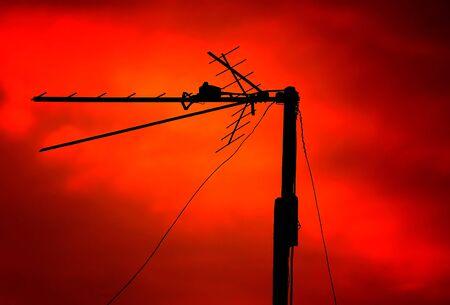 tv antenna: TV Antenna on the Red Sunset Sky Background