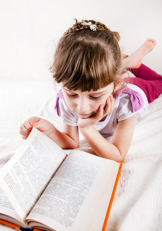 bibliophile: Little Girl with the Book on the Sofa