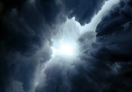 Light in the Dark and Dramatic Storm Clouds Stock Photo