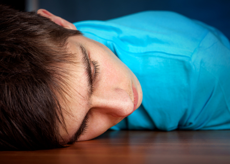 drowse: Young Man Sleeping on the Table closeup