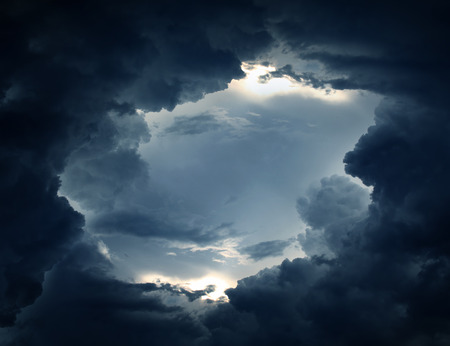 padding: Light in the Dark and Dramatic Storm Clouds Stock Photo