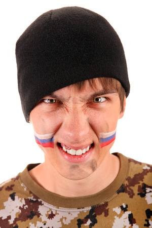 angriness: Young Man Portrait with Dirty Face and Russian Flag on the Cheeks