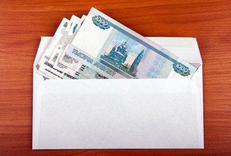 payola: Russian Rubles in Envelope on the Table closeup
