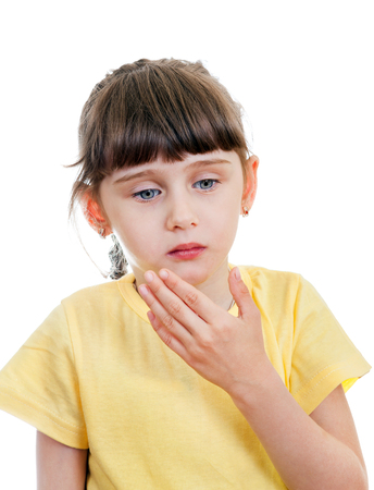 doleful: Sad Small Girl feel a Pain in a Tooth Stock Photo