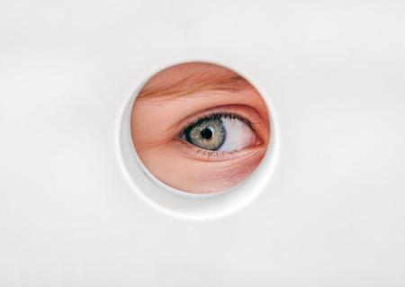 eye hole: Child Eye peeking through a Hole