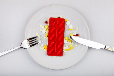 glut: Pills in the Plate on the Table Stock Photo