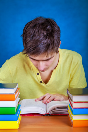 Student with the Books on the School Desk Stock Photo
