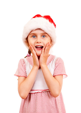 Surprised Small Girl in Santa Hat on the White Background