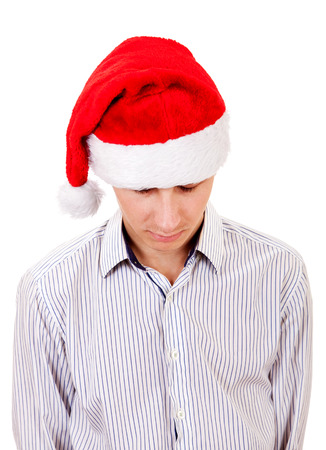 Sad Young Man Portrait in Santas Hat Isolated On The White Background