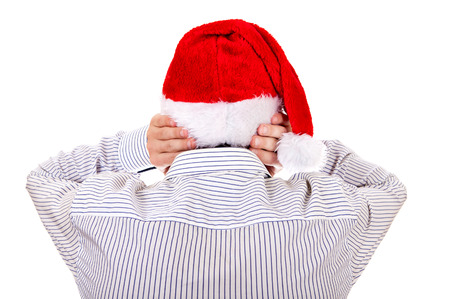 occiput: Rear View of Man in Santa Hat Covering his Ears on the White Background Stock Photo