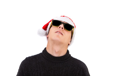 Young Man in Santa Hat and Sunglasses Isolated on the White Background Stock Photo