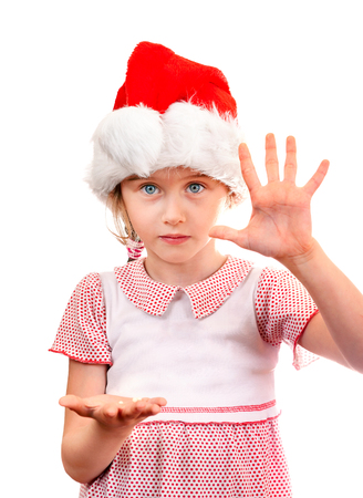 girlie: Small Girl in Santa Hat show the Palm on the White Background