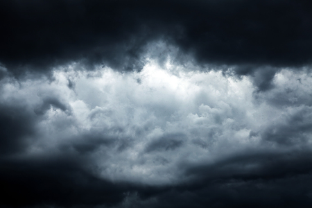 aureola: Dark and Dramatic Storm Clouds Area Background