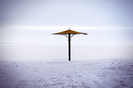 Toned Photo of Umbrella on the Snow at the Winter Beach