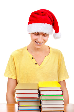 Cheerful Student in Santa Hat with a Books on the White Background