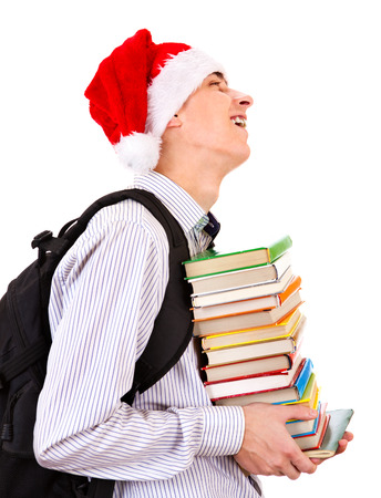 heaviness: Student in Santa Hat with a Books on the White Background