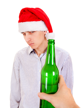 hesitant: Hesitant Young Man with a Beer Isolated on the White Background