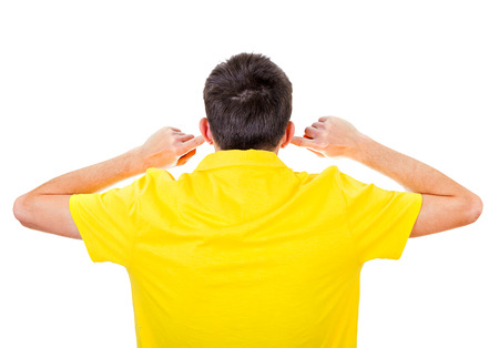 Rear View of Young Man Covering his Ears Isolated on the white background