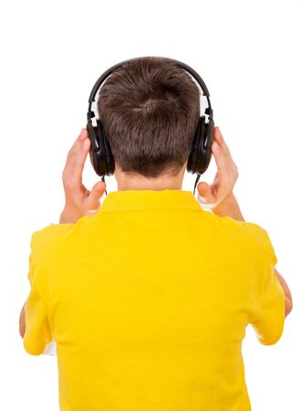 Rear View of the Young Man in Headphones Isolated on the White Background Stock Photo