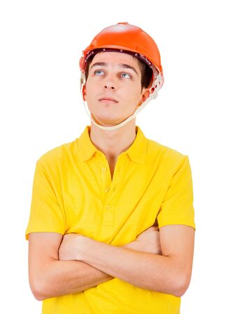 Pensive Young Man in Hard Hat Isolated on the White Background Stock Photo