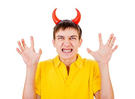 angriness: Angry Young Man with Devil Horns on the Head Isolated on the White Background Stock Photo