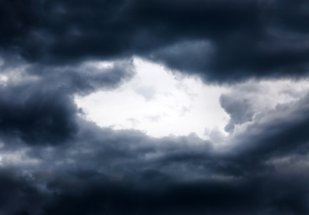 aureola: Hole of the Sky in the Dark Storm Clouds