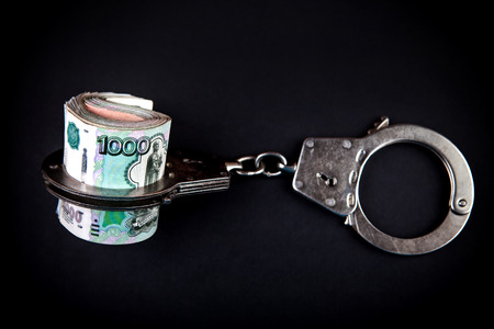 Russian Rubles and Handcuffs on the Black Background Stock Photo