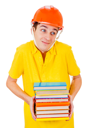 Doubtful Young Man in Hard Hat with a Books Isolated on the White Background