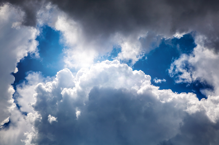 Dramatic Cloudscape Background with Hole of Blue Sky