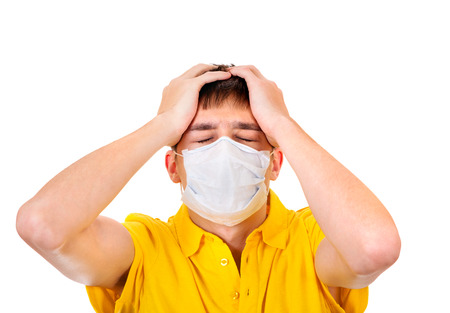 Sad Young Man in Flu Mask on the White Background