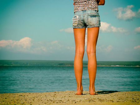 Toned Photo of Legs of the Girl at the Seaside Stock Photo