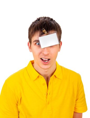 cardkey: Surprised Young Man with Empty Badge on his Head Isolated on the White Background