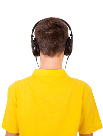 relish: Rear View of the Young Man in Headphones Isolated on the White Background Stock Photo