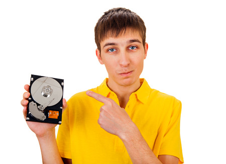 Young Man with Hard Disk Drive Isolated on the White Background