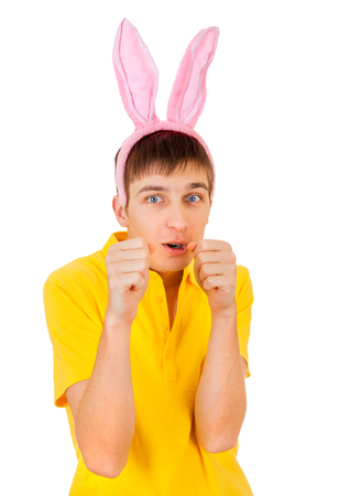 Young Man with Bunny Ears threaten with a Fist Isolated on the White Background