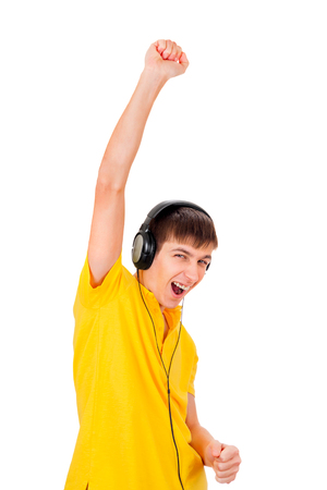 Young Man in Headphones listen to the Music and Dance Isolated on the White Background Stock Photo