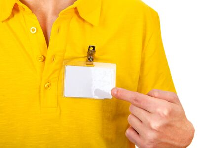 cardkey: Person shows blank Badge on t-shirt closeup