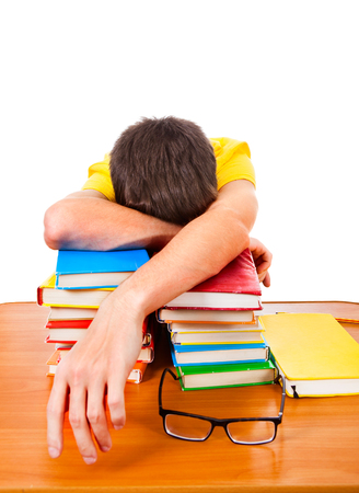 Tired Teenager sleep on the Books Isolated on the White