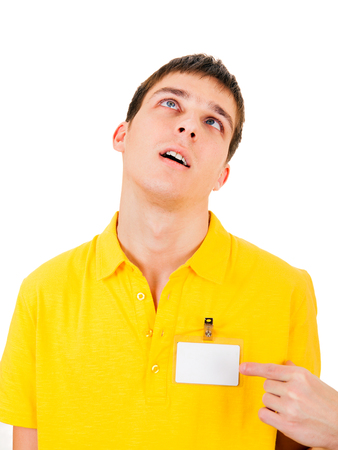 cardkey: Tired Young Man with Empty Badge on t-shirt Isolated on the White Background Stock Photo