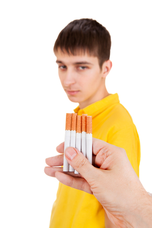 Young Man looking at Cigarettes on the White Background