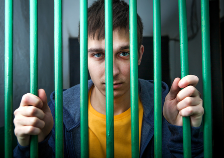 pokey: Jailed Young Man behind bars in a Cell