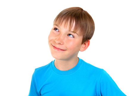 Happy Kid is Dreaming Isolated on the White Background Stock Photo
