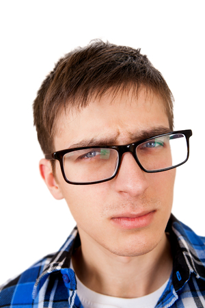 Young Man with sceptic look Isolated on the White Background