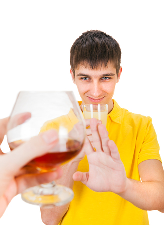 negation: Young Man with a Fruit Juice deny an Alcohol Isolated on the White Background