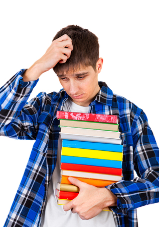Sad and Tired Teenager with the Books Isolated on the White Background Stock Photo