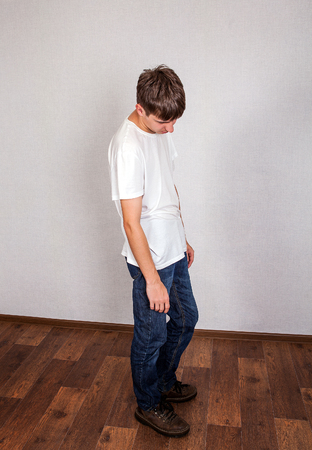 forlorn: Sad Young Man on the Floor in the Room Stock Photo