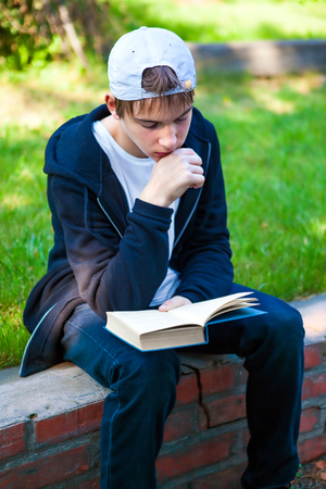 Teenager read a Books in the Summer Park Stock Photo