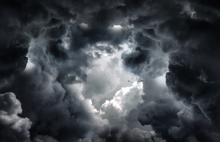 rupture: Tunnel in the Dark and Dramatic Clouds Stock Photo